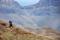 Hiking Drakensberg, South Africa. Hikers making their way up Giants Castle in the Drakensberg, South Africa Royalty Free Stock Photo
