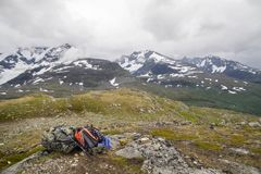Backpacker`s bag on top of mountain Royalty Free Stock Images