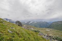 Travel in Norway mountains at summer. Hiking in dramatic weather in Europe nature reserve Stock Photos