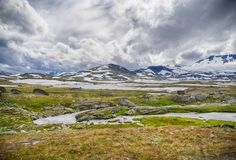 Travel in Norway mountains at summer. Hiking in dramatic weather in Europe nature reserve Royalty Free Stock Images