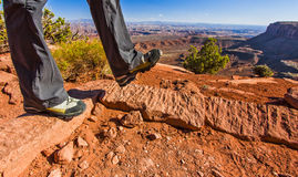 Hiking in the Dry Desert Terrain of Canyonlands Utah. Hiking trail in the desert landscape of Canyonlands National Park in Utah Royalty Free Stock Image