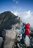 Hiking on eggishorn. Mother with childcarrier with baby hiking on eggishorn Stock Photo
