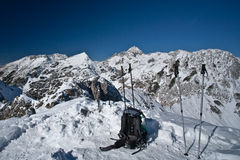 Hiking equipement on top. Hiking poles and backpack on top of the mountain with the view, alps, slovenia Stock Photo