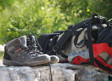 Hiking equipment. Traking boots and backpack at the grass background - hiking equipmen Stock Image