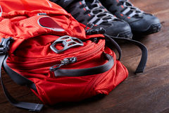 Hiking equipment: backpack and trekking boots on the wooden boards. Stock Image