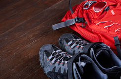 Hiking equipment: backpack and trekking boots on the wooden boards. stock images