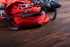 Hiking equipment: backpack and trekking boots on the wooden boards. royalty free stock photo