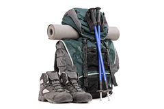 Hiking equipment, rucksack, boots, poles and slipping pad. Isolated on white background Stock Images