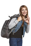 Excited girl with backpack howing OK gesture Stock Photos