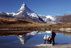 Hiking Family at Matterhorn. Family viewing Matterhorn at Leisee (lake), Zermatt, Switzerland Stock Images