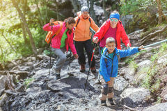 Hiking family in the mountains Royalty Free Stock Photos