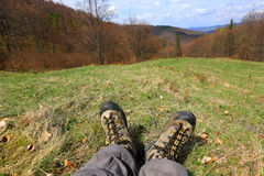 Hiking Feet on meadow Royalty Free Stock Photography