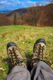 Hiking Feet on mountain meadow Stock Photography