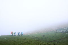 Hiking in fog Royalty Free Stock Photography