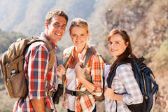 Hiking friends mountain. Group of hiking friends on top of mountain royalty free stock image