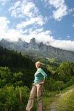 Hiking girl. View in alpine mountain pass in Switzerland stock photo