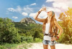 Hiking girl is drinking water Royalty Free Stock Image