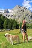 Hiking girl with her dog Royalty Free Stock Photo