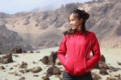 Hiking girl hiker in volcanic lanscape stock image
