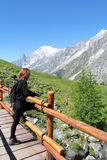 Hiking girl looks at alpine panorama Royalty Free Stock Images