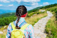 Hiking girl in the mountains Royalty Free Stock Photography