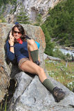 Hiking girl relax on a rock Royalty Free Stock Photo