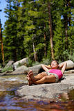 Hiking girl relaxing sleeping in nature forest Royalty Free Stock Photos