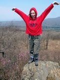 Hiking girl on the rock  Royalty Free Stock Photo