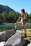 Hiking girl with walking sticks Royalty Free Stock Images