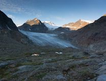 Hiking on glacier in Alps stock image