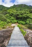Hiking the granite stairway in the jungle, mahé, seychelles 4. Hiking a granite stairway to the top of a hill in the jungle in the mountains on mahé Stock Image