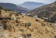 Hiking group descending  along Poqueira Gorge to Capileira, Spai Stock Images