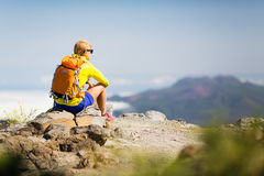 Hiking happy woman relaxing in mountains Royalty Free Stock Photo
