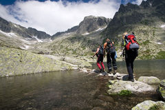 Hiking in high mountains Stock Photography