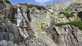 Skok waterfall Vodopad Skok in High Tatras, Slovakia. Hiking in High Tatras Mountains Vysoke Tatry, Slovakia. Panoramic view of mountains near Skok waterfall stock footage