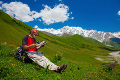 Hiking. Hiker have rest in Caucasus mountains Stock Photos