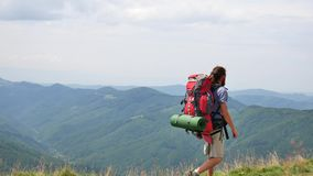 Hiking - hiker man on trek with backpack living healthy active lifestyle. Hike in mountain nature