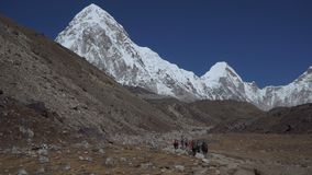 Hiking in Himalaya mountains. A group of tourists on the way to the base camp of Everest in the Himalayas stock footage