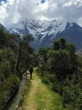 Hiking with an Inca guide through the Andes on the Salkantay trek on the way to Macchu Picchu, Peru stock image
