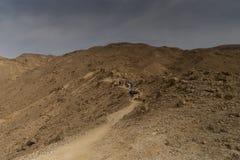 Hiking in israeli stone desert. Israel travel trek in desert backpackers tourism Royalty Free Stock Photos