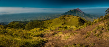 Hiking in Java province. Panoramic photo of  Mount Merbabu and surrounding area near Yogya in central Java province in Indonesia. In this region, one can only Stock Photo