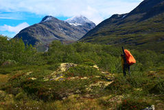 Hiking in Jotunheimen National Park. Young woman with big backpack hiking in Jotunheiman National Park, Norway Royalty Free Stock Photography