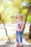Hiking kid girl searching hand in head in forest. Outdoor royalty free stock photos