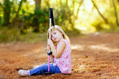 Hiking kid girl tired sitting in autumn forest Royalty Free Stock Images