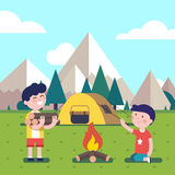 Hiking kids at the campfire Royalty Free Stock Images