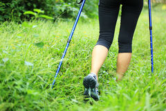 Hiking legs on green grass Stock Photos