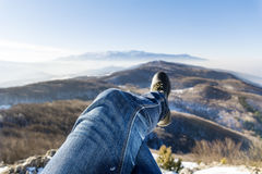 Hiking legs on a  mountains landscape background Stock Photos
