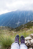 Hiking legs on a  mountains landscape background Stock Photography
