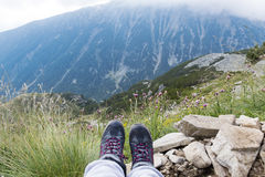 Hiking legs on a  mountains landscape background Stock Image