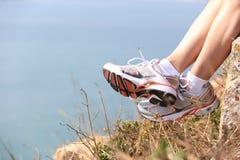 Hiking  legs sit seaside rock Royalty Free Stock Photo